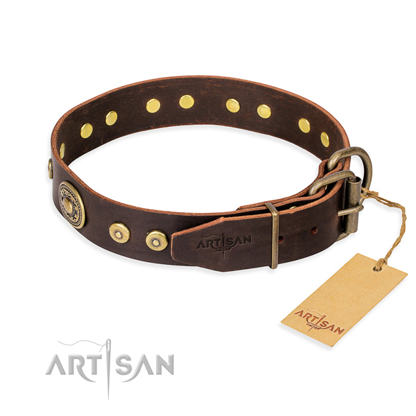 Natural genuine leather dog collar made of soft to touch material with corrosion resistant adornments